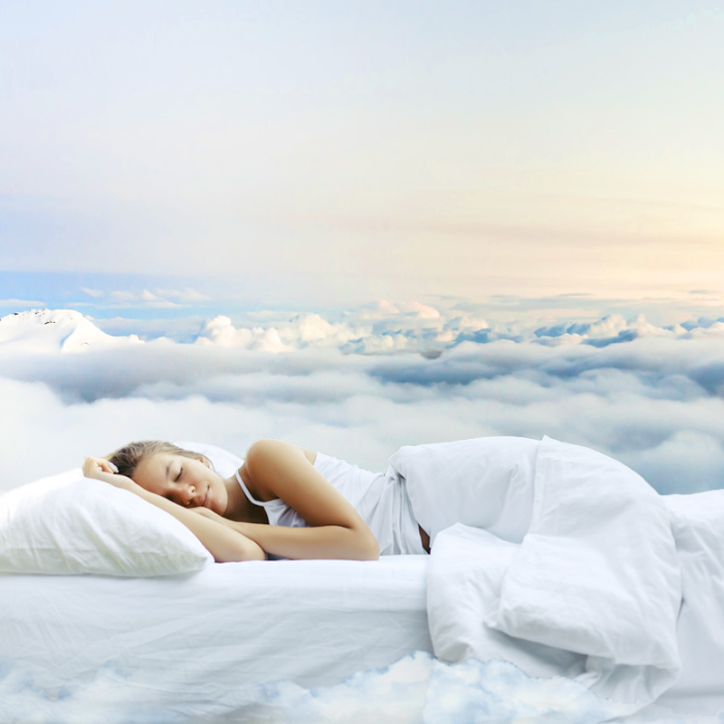 girl sleeping peacefully on a soft mattress in the clouds