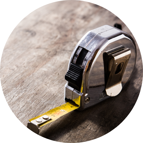tape measure being used to meausre sizes for custom mattress